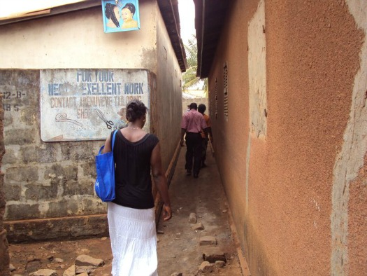 """Our walk through the village to the children's home.  """"Watch where you step!"""""""